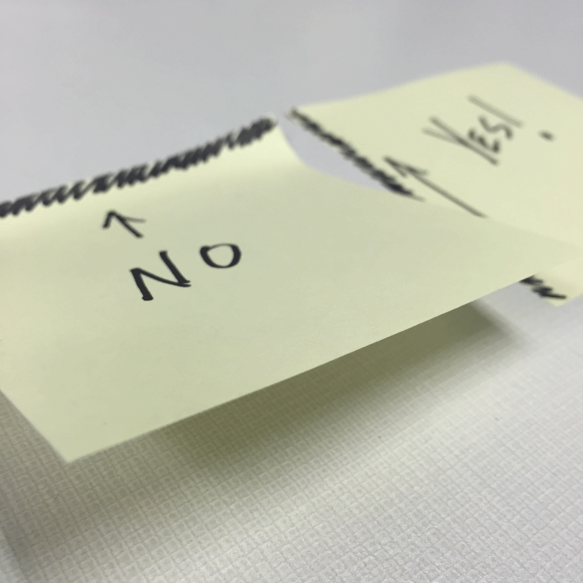 The wrong way to peel post-it notes and the right way side by side