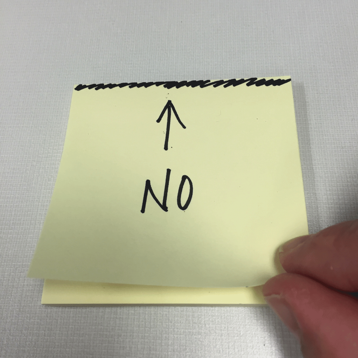 The wrong way to peel post-it notes